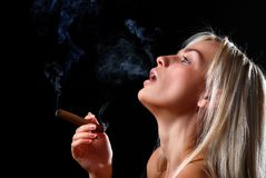 Woman with cigar Stock Images