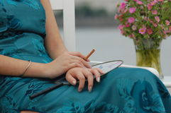 Woman with cigar and flowers Stock Photos