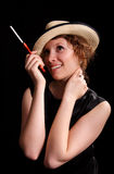 Woman with a cigarette. Young woman with a cigarette on a black background Stock Images