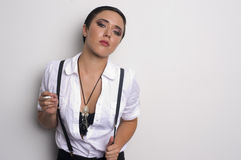 Woman Smoking Cigarette Suspenders Against Wall Royalty Free Stock Image