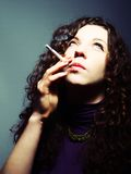 Woman and a cigarette Stock Photos
