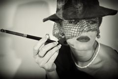Woman with  cigarette in hat with veil Royalty Free Stock Photo
