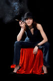 Woman with cigarette holder Stock Images