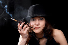 Woman with cigarette holder Stock Photography