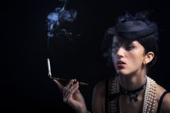 Woman with cigarette vintage hat Stock Photos