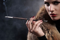 Woman with cigarette in vintage image Stock Photo