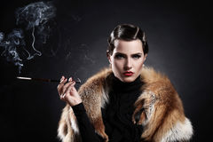 Woman with cigarette in vintage image Stock Image