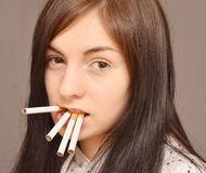 Woman with cigarettes Royalty Free Stock Photo