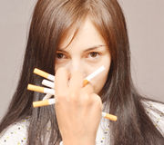 Woman with cigarettes Stock Images