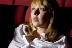 Woman in cinema Stock Images