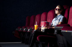 Woman at the cinema Stock Photography