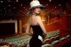 Woman in cinema Stock Image