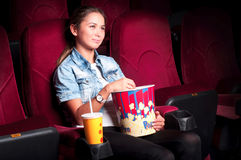 Woman at the cinema Stock Images
