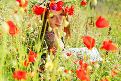 Woman and circlet of flowers Royalty Free Stock Photo