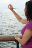 Woman circling statue of liberty with hand Stock Photography