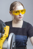 Woman with a circular disk saw Stock Photos