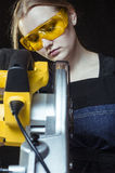 Woman with a circular disk saw Stock Photo