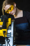 Woman with a circular disk saw Stock Photography