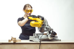 Woman with a circular disk saw Royalty Free Stock Photo