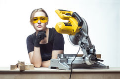 Woman with a circular disk saw Royalty Free Stock Image