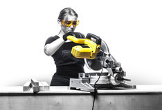 Woman with a circular disk saw Royalty Free Stock Photos