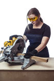 Woman with a circular disk saw Royalty Free Stock Images