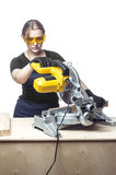 Woman with a circular disk saw Royalty Free Stock Photography
