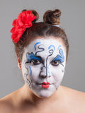 Woman with circus makeup. Royalty Free Stock Photography