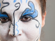 Woman with circus makeup Stock Photo