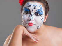 Woman with circus makeup Stock Images