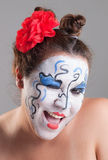 Woman with circus makeup Stock Image