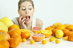 Woman with citrus fruit Royalty Free Stock Images