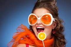 Woman with citrus lollipop Stock Photos