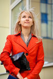 Woman in the city. Beautiful woman looking in the sky Stock Image