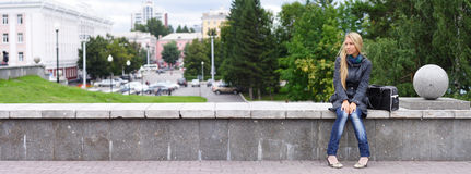 Woman in city. Young woman on a urban background. panoramic view Royalty Free Stock Image