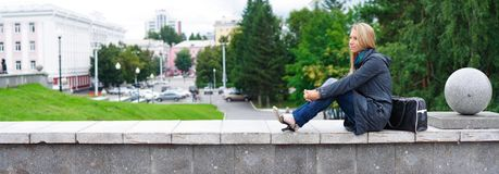 Woman in city. Young woman on a urban background. panoramic view Royalty Free Stock Photography