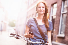 Woman in City - Bicycle and Mobile Phone Royalty Free Stock Photo