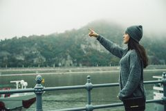 Woman at city dock in foggy day royalty free stock photo