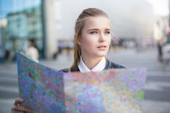 Woman with city map lost in big city Royalty Free Stock Image