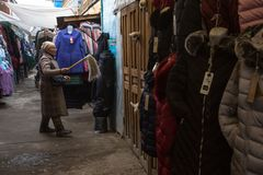 Woman in the city market sells clothes. In Bayan-Olgiy province is populated to 88,7% by Kazakhs. Royalty Free Stock Images