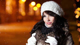 Woman in city at night. Stock Image