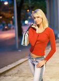 Woman in a city at night Stock Photos