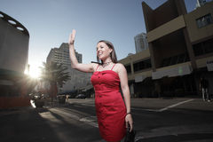 Woman in the city waving Royalty Free Stock Images