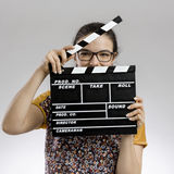 Woman with a clapboard Royalty Free Stock Photography