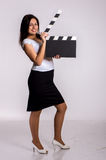 Woman with clapboard Stock Image