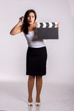Woman with clapboard Royalty Free Stock Image