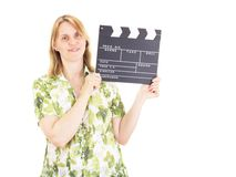 Woman with clapperboard having fun on location Stock Photography