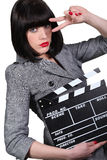 Woman with a clapperboard royalty free stock photo