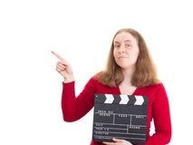 Woman with clapperboard pointing at something Stock Image