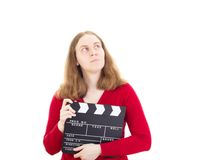 Woman with clapperboard thinking about something Royalty Free Stock Images